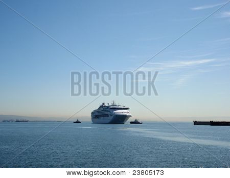 Princess Cruiseship Being Pulled By Tugboats For Repairs