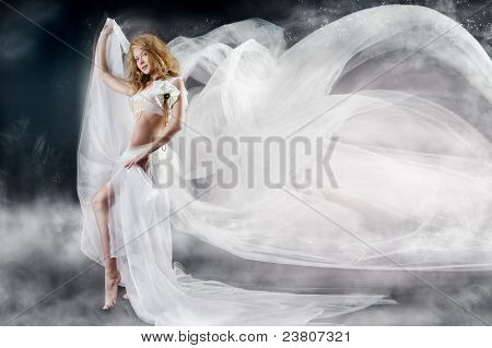 Beautiful Woman With Flying White Chiffon Fabric A Wind Flow. Fantasy Background