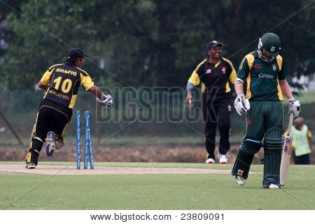PUCHONG, MALAYSIA - SEPT 24: Malaysia's fielders celebrate Guernsey's Tim Ravenscroft's dismissal in this Pepsi ICC WCL Div 6 finals at the Kinrara Oval on September 24, 2011 in Puchong, Malaysia.
