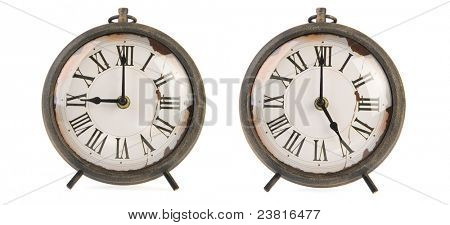 Vintage clocks with nine to five isolated over white background