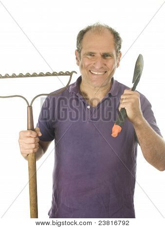 Middle Age Senior Man Gardener With Spade And  Bow Rake Tools