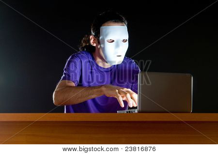 Hacker sitting in dark room
