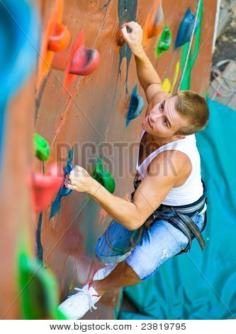 men climbing on a wall