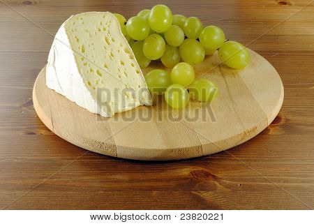 Italian cheese with grapes