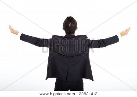 Successful businessman back view isolated on white