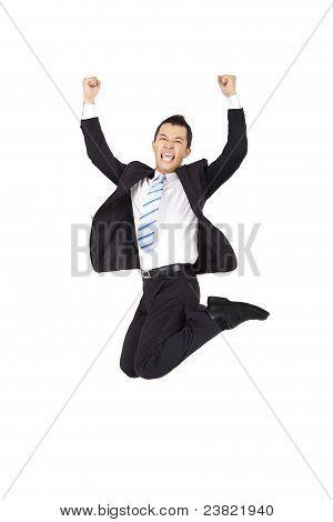 empresário feliz pulando e isolado no fundo branco