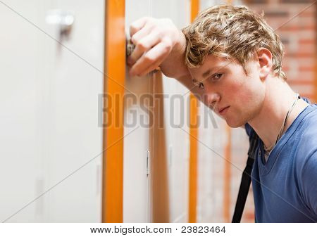 Close Up Of A Lonely Student Leaning On A Locker