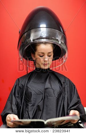 Portrait Of A Woman Under A Hairdressing Machine