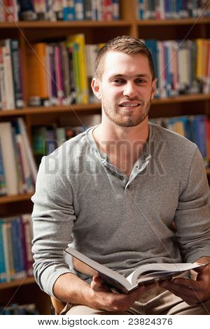 Portrait Of A Male Student Holding A Book