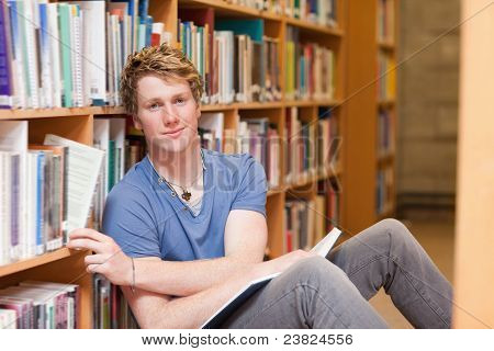 Handsome Student Picking A Book