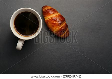 poster of Coffee Mug On Black Background. White Coffee Mug And Croissant On Black Background. Fresh Croissants