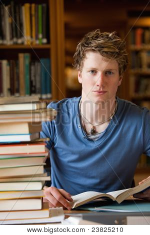 Portrait Of A Male Student Posing With Books