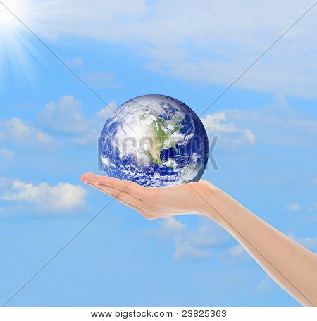 Planet Earth in the female hand
