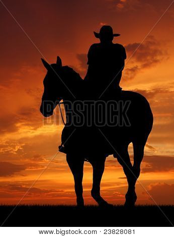 Silhouette cowboy with horse in the sunset