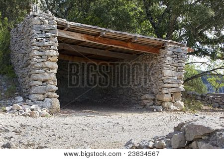 Old Ruined Stone Shelter In The Countryside