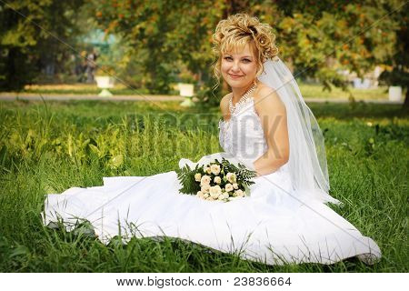 Happy Bride At A Park In Grass