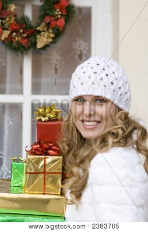 Happy Woman Bringing Christmas Gifts