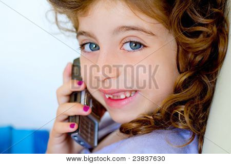 Child girl indented talking mobile telephone smiling happy
