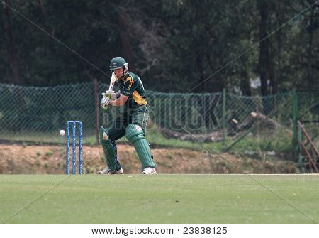 PUCHONG, MALAYSIA - SEPT 24: Guernsey's batsman Jeremy Frith hits at the ball in this Pepsi ICC World Cricket League Div 6 finals vs Malaysia at the Kinrara Oval on Sept 24, 2011 in Puchong, Malaysia.