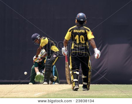 PUCHONG, MALAYSIA - SEPT 24: Malaysia's Mohd Safiq (10) watches Aminuddin bat in this Pepsi ICC World Cricket League Div 6 finals vs Guernsey on Sept 24, 2011 at the Kinrara Oval, Puchong, Malaysia.