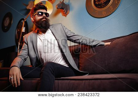 Brutal Bearded Man Sitting In