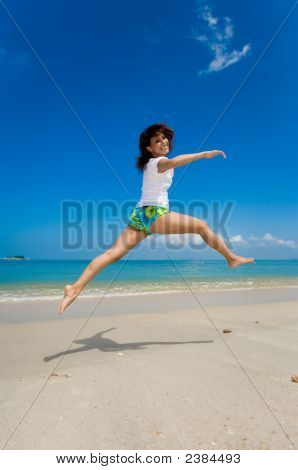 Happy Jump At The Beach