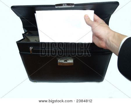 Businessman Showing Some Papers From Briefcase