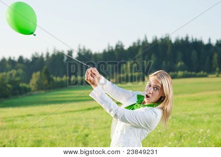 Happy Young Woman With Green Balloon Meadows