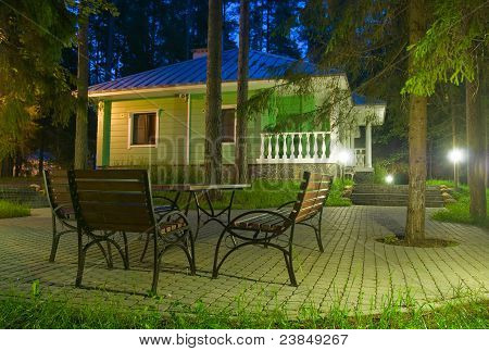 Cabin in the night forest