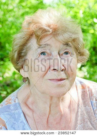 portrait of a happy senior woman in the garden