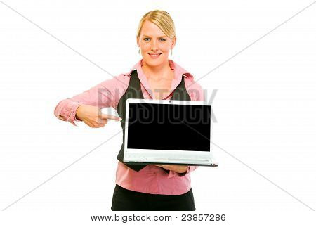 Happy Business Woman Pointing On Laptops Blank Screen