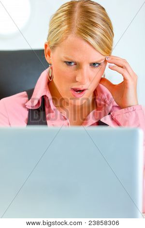 Portrait Of Confused Business Woman Looking On Laptop