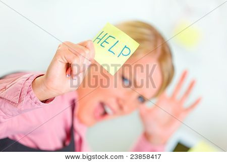 Stressed Business Woman Showing Sticky Note With Help Word