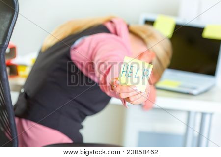 Tired Business Woman Showing Sticky Note With Help Word