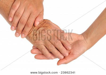 Hands of young and senior women