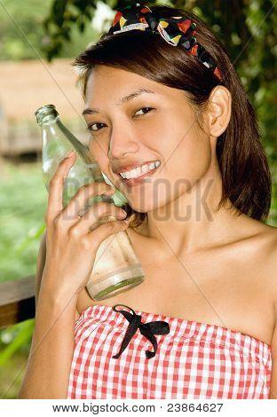 Girl holding a bottle