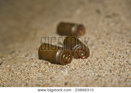 Empty cartridges on sand