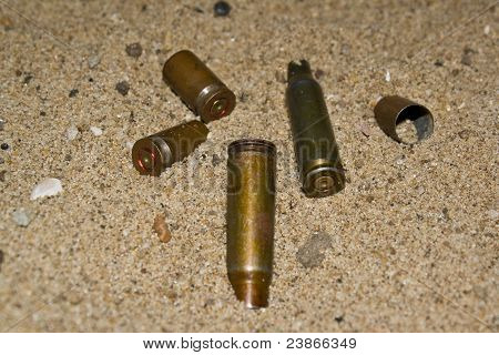 Empty cartridges on sand