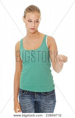 Young sad student girl pointing on something, isolated on white background