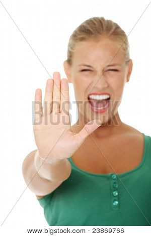 bright picture of young woman making stop gesture. Isolated on white background.
