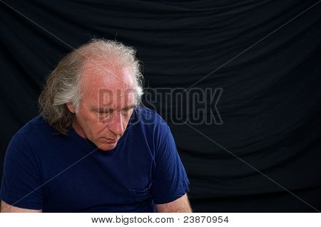 Man Looking Down And Slouching