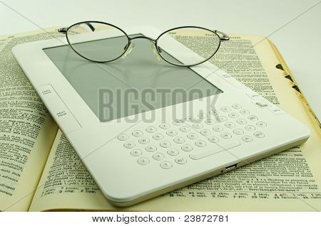 e book paper book and spectacles