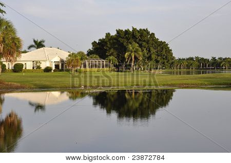 Home Reflection In Pond