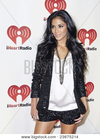 LAS VEGAS - SEPTEMBER 24: Nicole Scherzinger appears on the red carpet at the 2011 iHeartRadio Music Festival on September 24, 2011 at the MGM Grand Garden Arena in Las Vegas, Nevada.