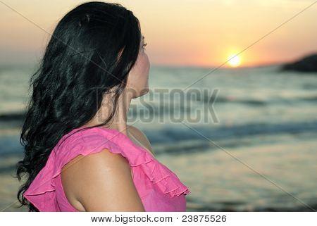Woman Admire Sunset At Sea