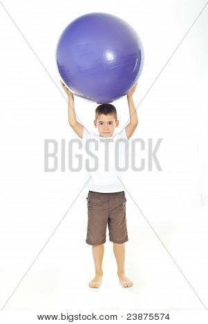 Boy Holding Big Ball On Head
