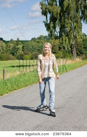 Inline Skating Young Woman On Sunny Asphalt Road