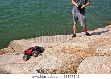 Rc Toy Car On A Stone Terrain