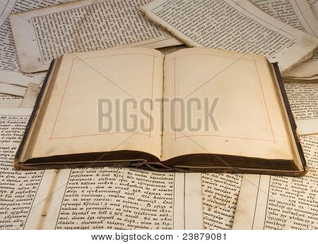 Open old book with empty pages