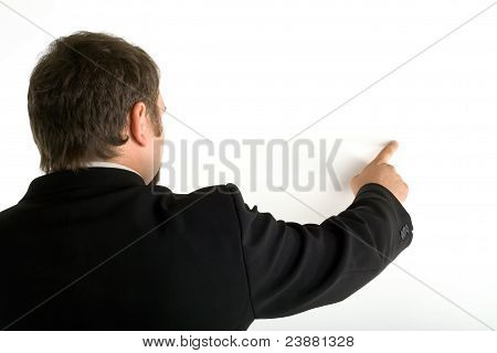 Standing Behind A Man Shows His Index Finger